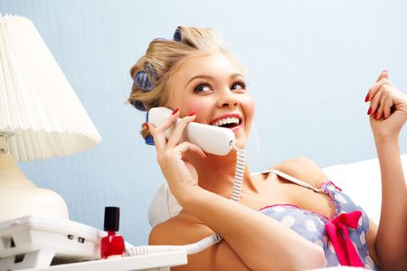 Portrait of female in curlers speaking on the telephone at home Stock Photo - 6118863