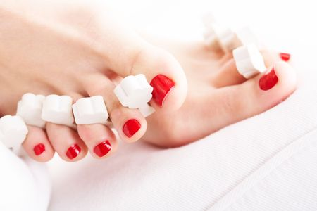 human toe: Close-up of female feet with red polished nails Stock Photo