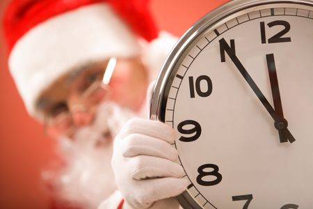 Photo of clock showing five minutes to midnight with Santa on background photo