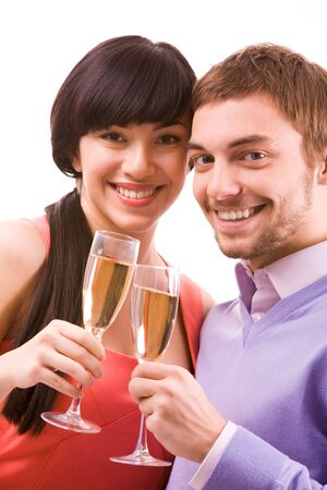 Portrait of happy couple with champagne flutes celebrating holiday photo