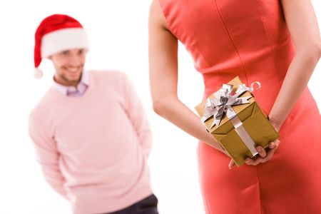 Rear view of woman in red dress holding giftbox in hand on background of her husband photo