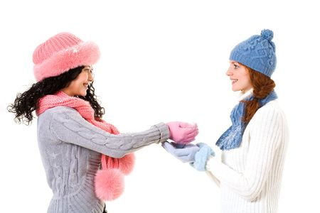 Profiles of happy girl giving snow to her friend over white background photo
