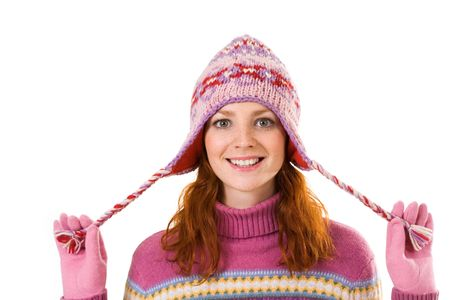 Face of pretty woman in pink winter cap looking at camera with smile photo
