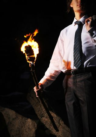 burning man: Image of businessman with flame in darkness