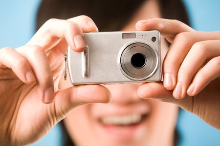 Image of photo camera in male hands ready to make a shot photo