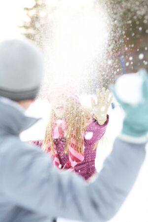 fling: Image of attractive young woman flinging the snowball and having fun