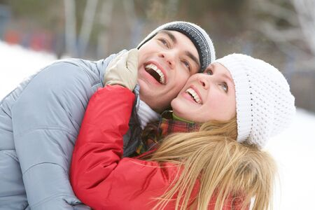 looking upwards: Portrait of happy couple looking upwards and laughing  Stock Photo