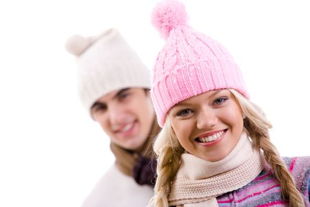 Portrait of happy girl in pink knitted cap on background of her boyfriend photo