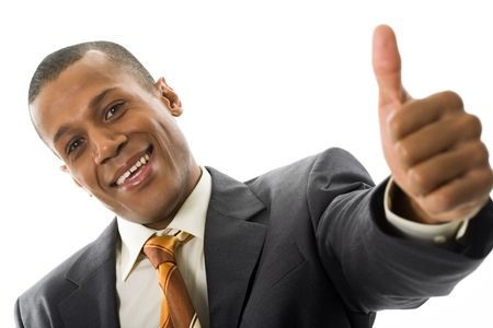Happy businessman showing his thumb up with smile over white background Stock Photo - 6226585