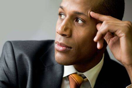 Pensive employee thinking of new ideas and looking aside photo