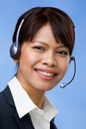 Image of successful professional in headset looking at camera with smile photo
