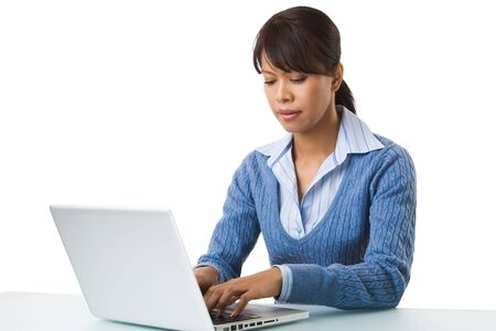 Image of young successful employer typing on laptop at workplace Stock Photo - 6226558