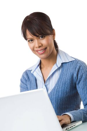 Image of young successful employer typing on laptop and smiling at camera Stock Photo - 6226605