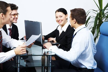 Photo of co-workers looking at each other with smiles while working Stock Photo - 6226616