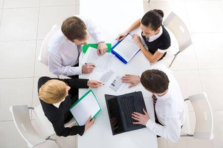 workteam: Above view of friendly workteam discussing business plan at meeting Stock Photo