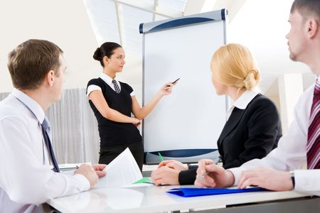 Smart and confident employee pointing at whiteboard while presenting her ideas Stock Photo - 6614325