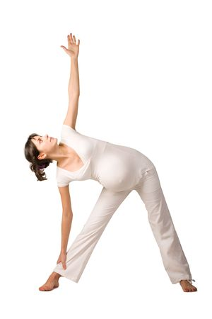 Portrait of pretty pregnant woman practicing physical exercise over white background photo