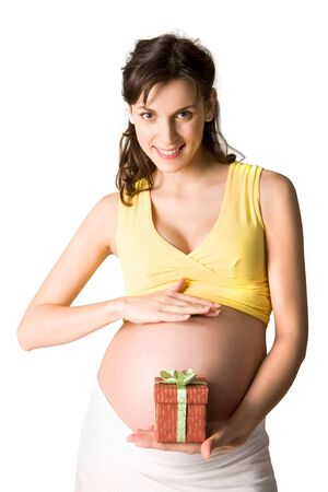 Pretty pregnant woman with small giftbox on palm looking at camera photo