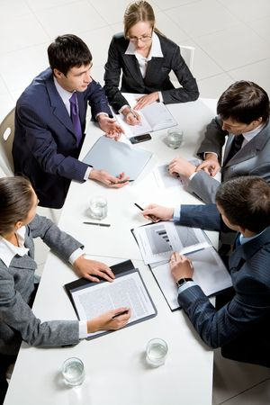 Team of several business people discussing an important question at briefing  Stock Photo - 6614509