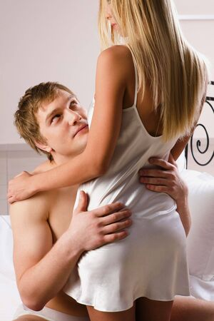 man and woman sex: Photo of handsome man embracing his wife and looking at her Stock Photo
