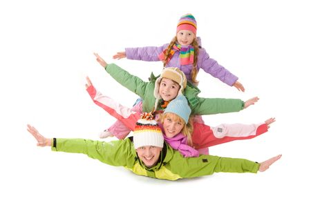 Happy family members lying with their arms stretched photo