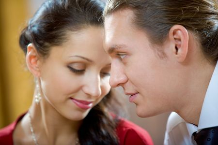 flirtatious: Image of handsome man looking at shy woman Stock Photo