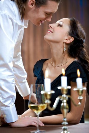 Image of handsome man flirting with beautiful woman Stock Photo - 6614463