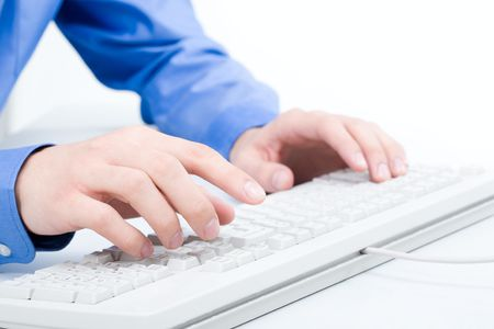 Close-up of male hand touching buttons of white computer keyboard Stock Photo - 6669409