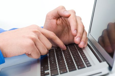 Close-up of male hand over laptop keyboard while the other one hiding forefinger photo