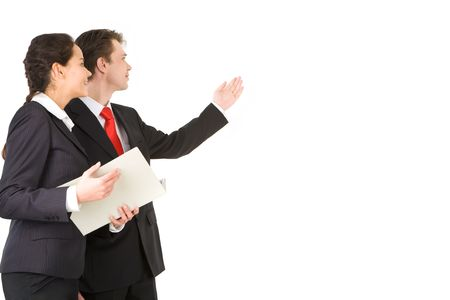 Portrait of businessman pointing at wall with woman near by Stock Photo - 6637766