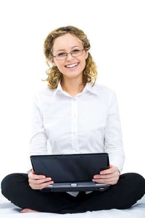 Image of pretty female holding laptop and looking at camera photo