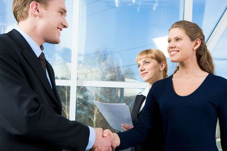 Photo of handshake of businesspeople in the office after making agreement photo