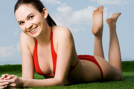 hot girl lying: Portrait of happy woman looking at camera while enjoying hot summer day Stock Photo
