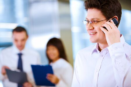 Image of handsome businessman speaking on the phone  Stock Photo - 6637823