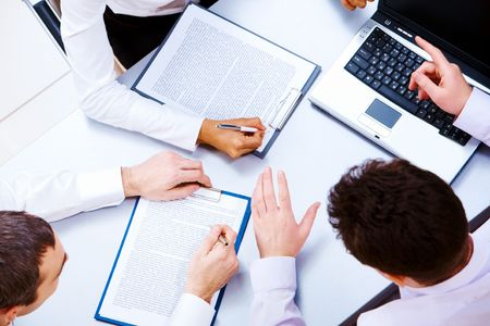 Above view of several business partners interacting at meeting Stock Photo - 6637785