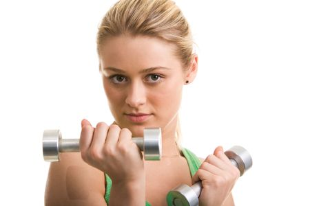 Image of blonde young woman with barbells looking at camera photo