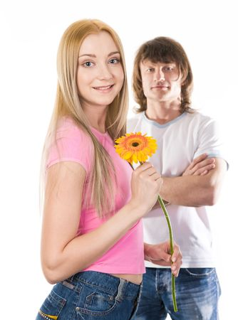 herbera: Image of cute girl with beautiful herbera looking at camera on background of her boyfriend