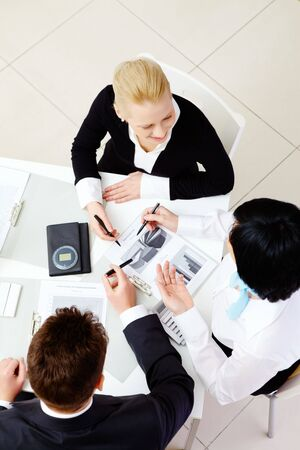 Above view of friendly workteam discussing business plan at meeting Stock Photo - 6669707