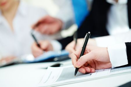 Close-up of business person hands working with document Stock Photo - 6669647