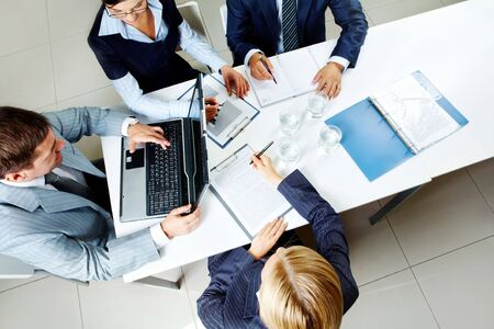 Image of company of successful partners discussing business plan at meeting Stock Photo - 6669624