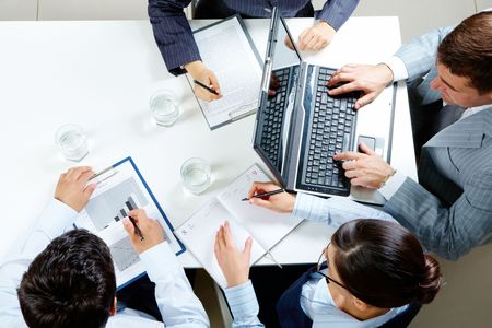 Image of company of successful partners planning work at meeting Stock Photo - 6669685