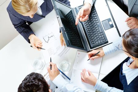Above view of business people working with documents at meeting Stock Photo - 6669690