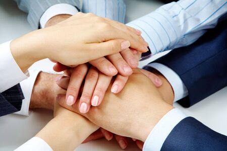 workgroup: Close �up of business people�s hands on top of each other  Stock Photo