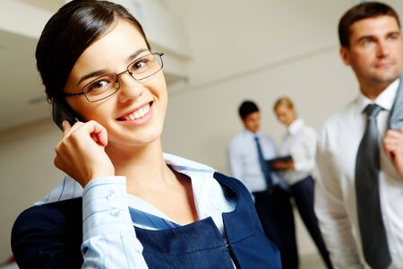 Photo of pretty business leader with glasses talking by mobile phone Stock Photo - 6669623