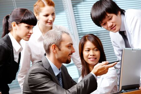 company profile: Portrait of executive employees interacting in office Stock Photo