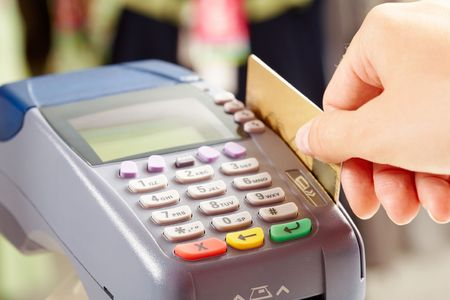 Close-up of payment machine buttons with human hand holding plastic card near by Stock Photo - 6669591
