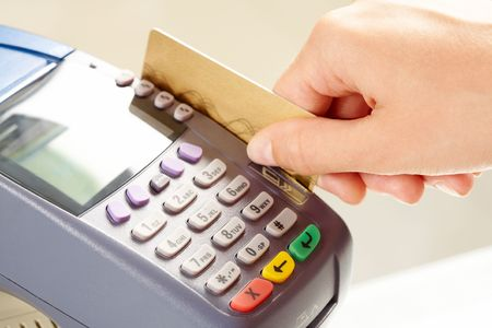 key card: Close-up of payment machine while human hand keeping plastic card in it