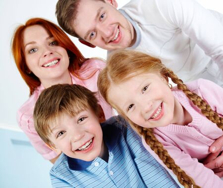 Happy couple and their two children smiling while looking at camera Stock Photo - 6669606