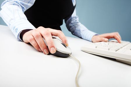 Close-up of human hand on white mouse during computer work Stock Photo - 6669818