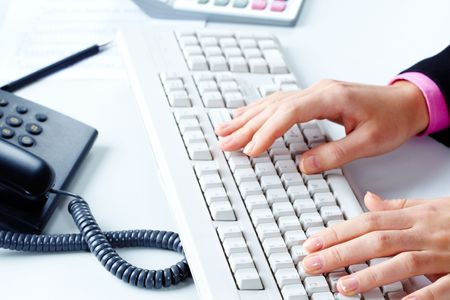 Close-up of female�s hands touching keys of computer board in office photo